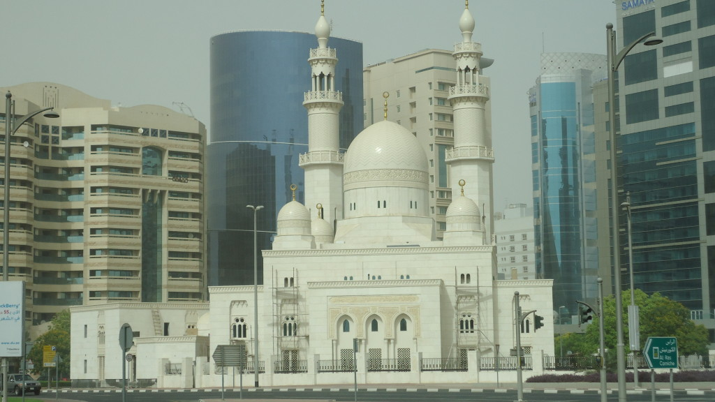 Mosque in Dubai among the modern buildings.