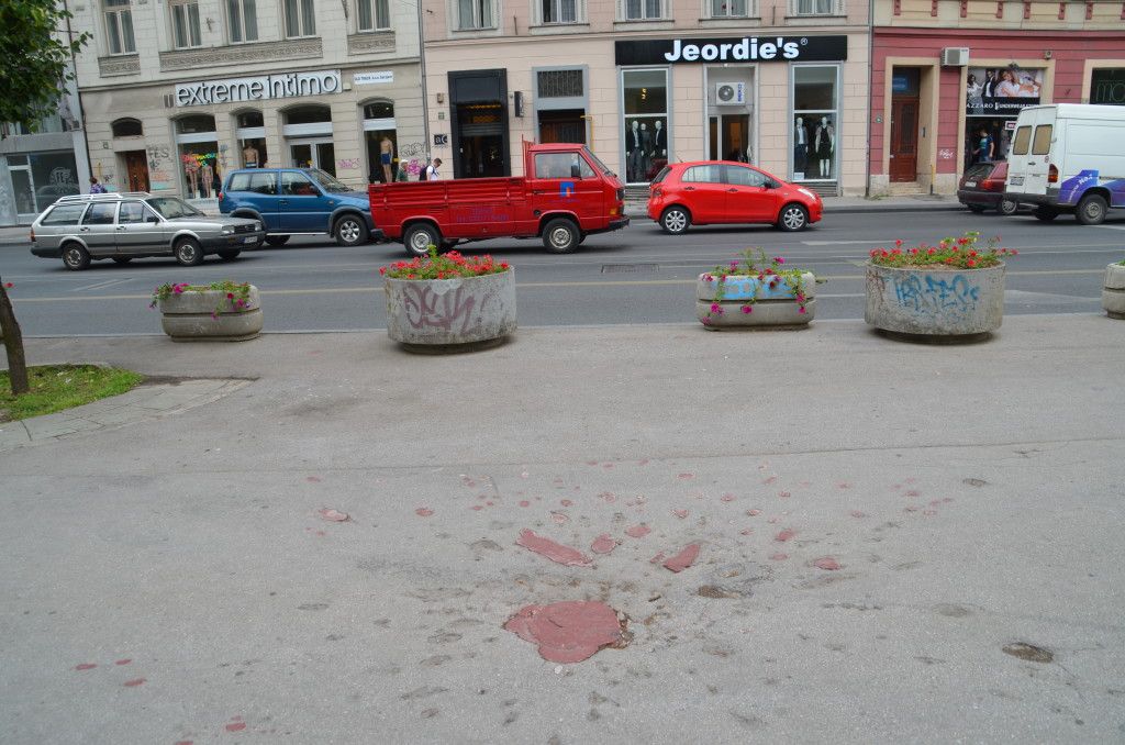 One of Sarajevo's Roses- mortar shell crater filled in with red resin
