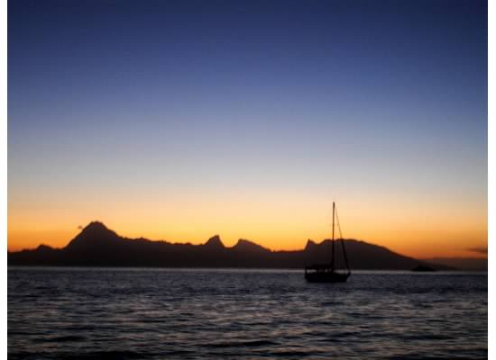 The sun setting over Moorea and our honeymoon