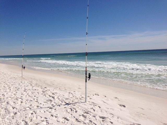 Empty Florida beaches in February except for a couple of fishing poles