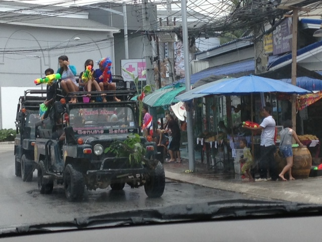 Truck full of people with water guns